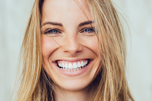a patient with customized lingual braces from Dr. Amy James and Associates Orthodontists